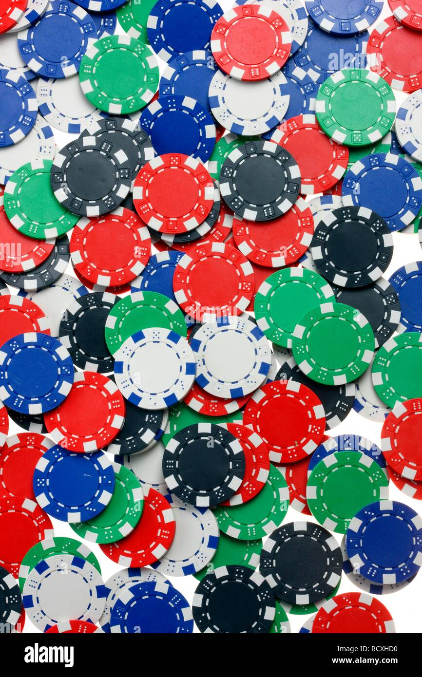 Poker, gaming chips, tokens, with different values - Stock Image