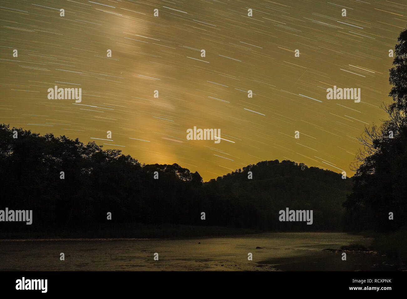 Sky with stars above the water. Bieszczady Mountains. Poland - Stock Image