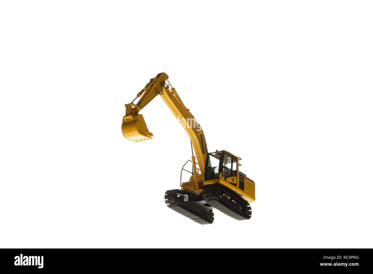 Excavator construction machinery isolated on white background - Stock Image