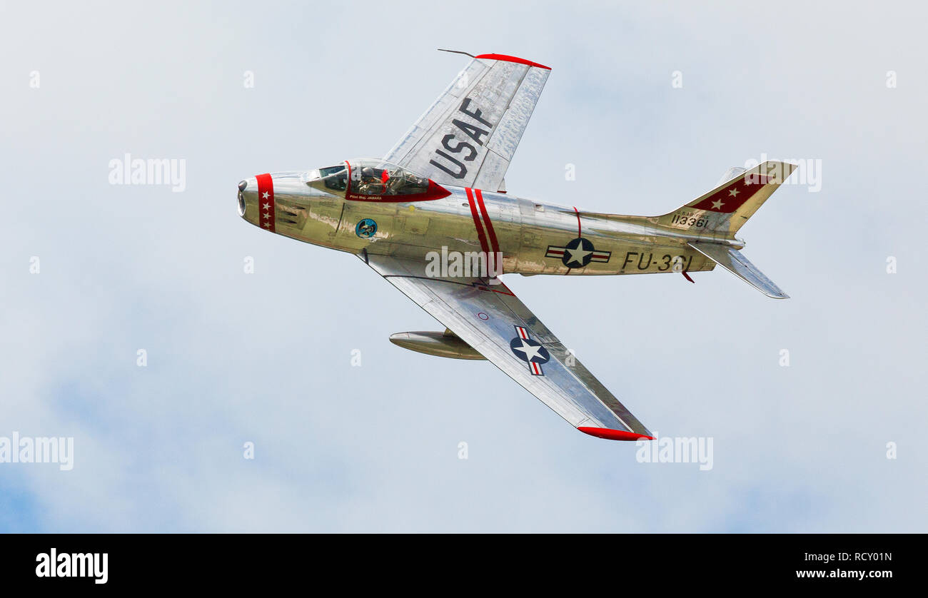 North American F-86 Sabre, transonic swept wing jet fighter from the Korean War performs at air show - Stock Image