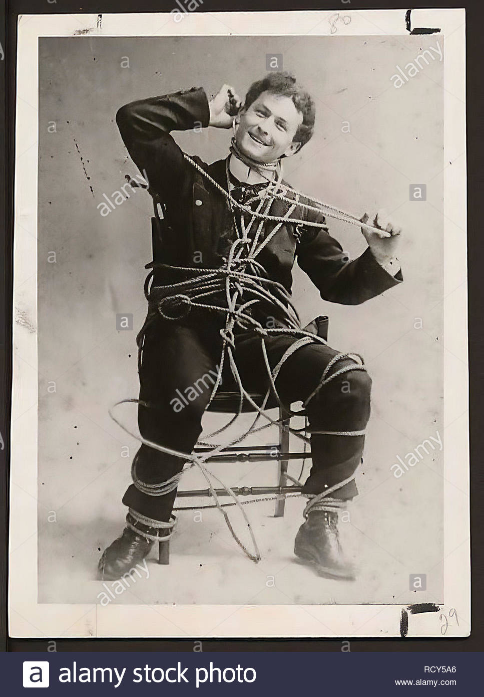 Harry Houdini (March 24, 1874 Ð October 31, 1926) was a Hungarian-born American illusionist and stunt performer, known for his sensational escape acts - Stock Image