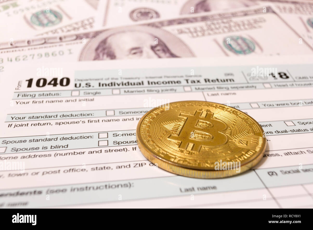 Bitcoin and 2019 calendar with 1040 income tax form for 2018