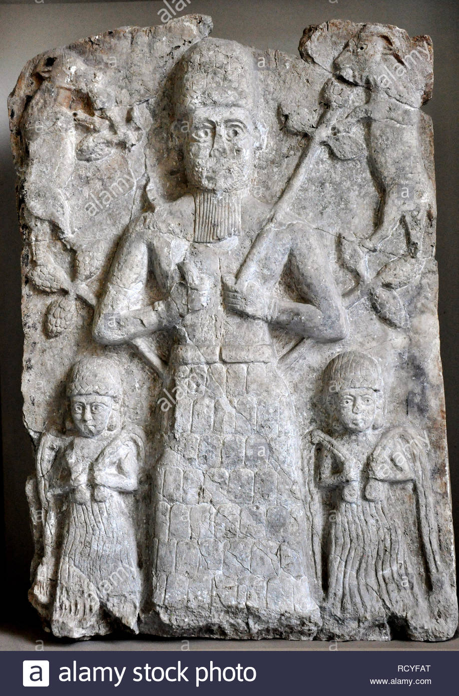 6412. Relief depicting the God Assur with two smaller water goddesses on each side. Temple of Assur , Mesopotamia c. 2000 BC. Stock Photo