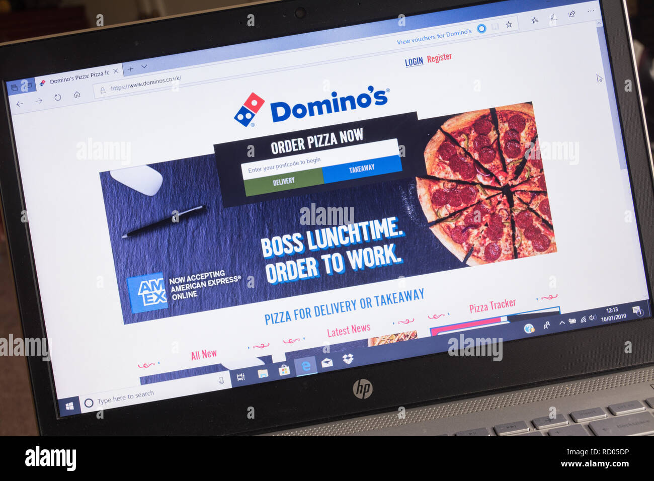 Domino's pizza website screenshot on laptop computer. Advert for takeaway fast food - Stock Image