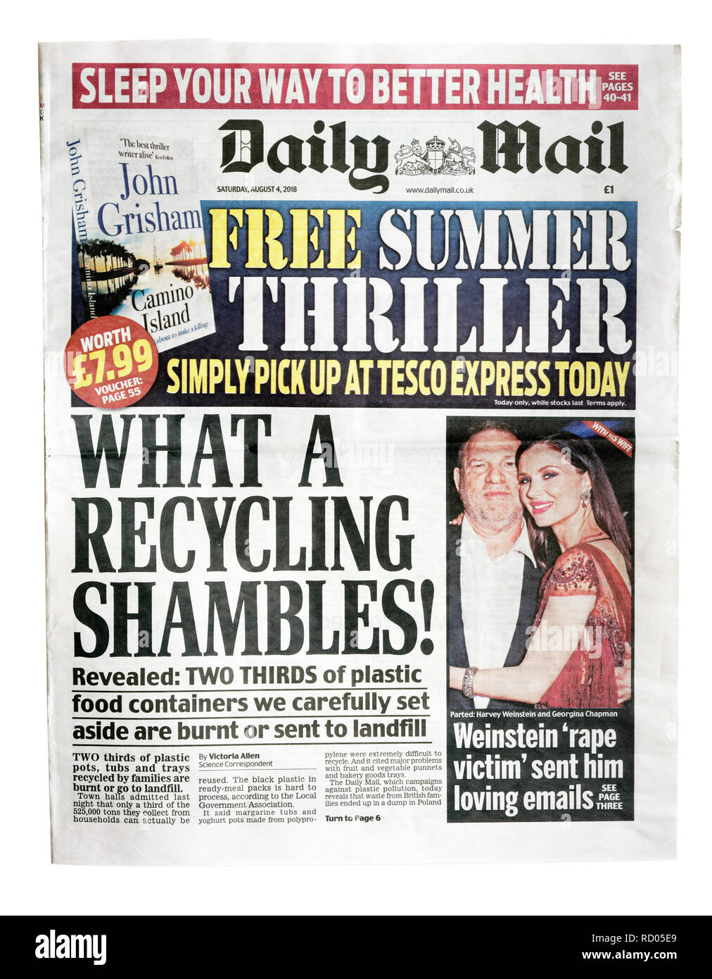The front page of the Daily Mail with the headline What A Recycling Shambles, the story that most of recycled plastic is sent to landfill - Stock Image