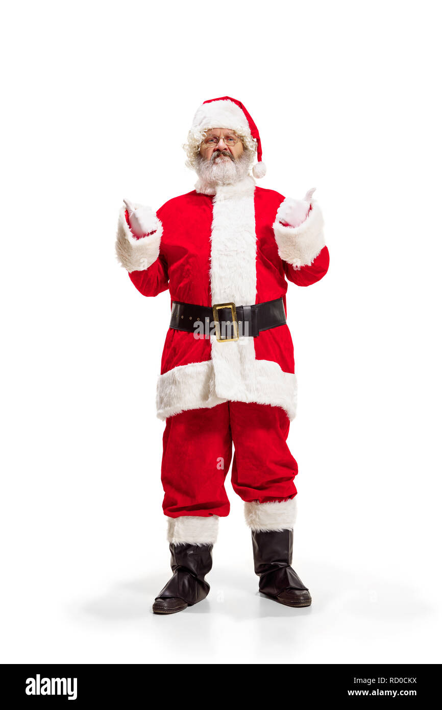 Hey, hello. Holly jolly x mas festive noel. Full length of funny happy santa in headwear, costume, black belt, white gloves, waves with arm palm standing at studio over white background - Stock Image