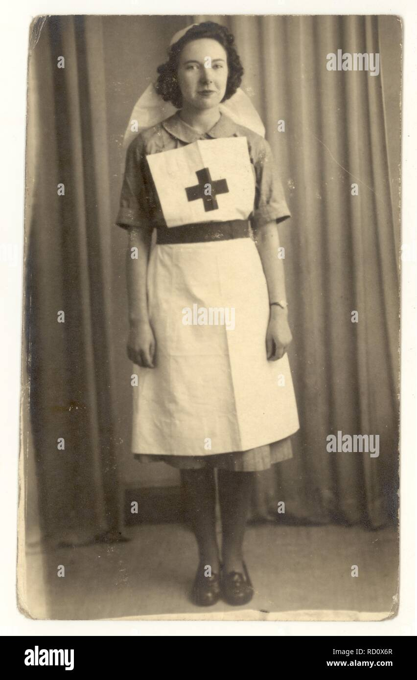 Columbia Studios portrait of an attractive young WW2 era Red Cross volunteer nurse, wearing a Voluntary Aid Detachment (VAD) uniform, circa 1940 - Stock Image