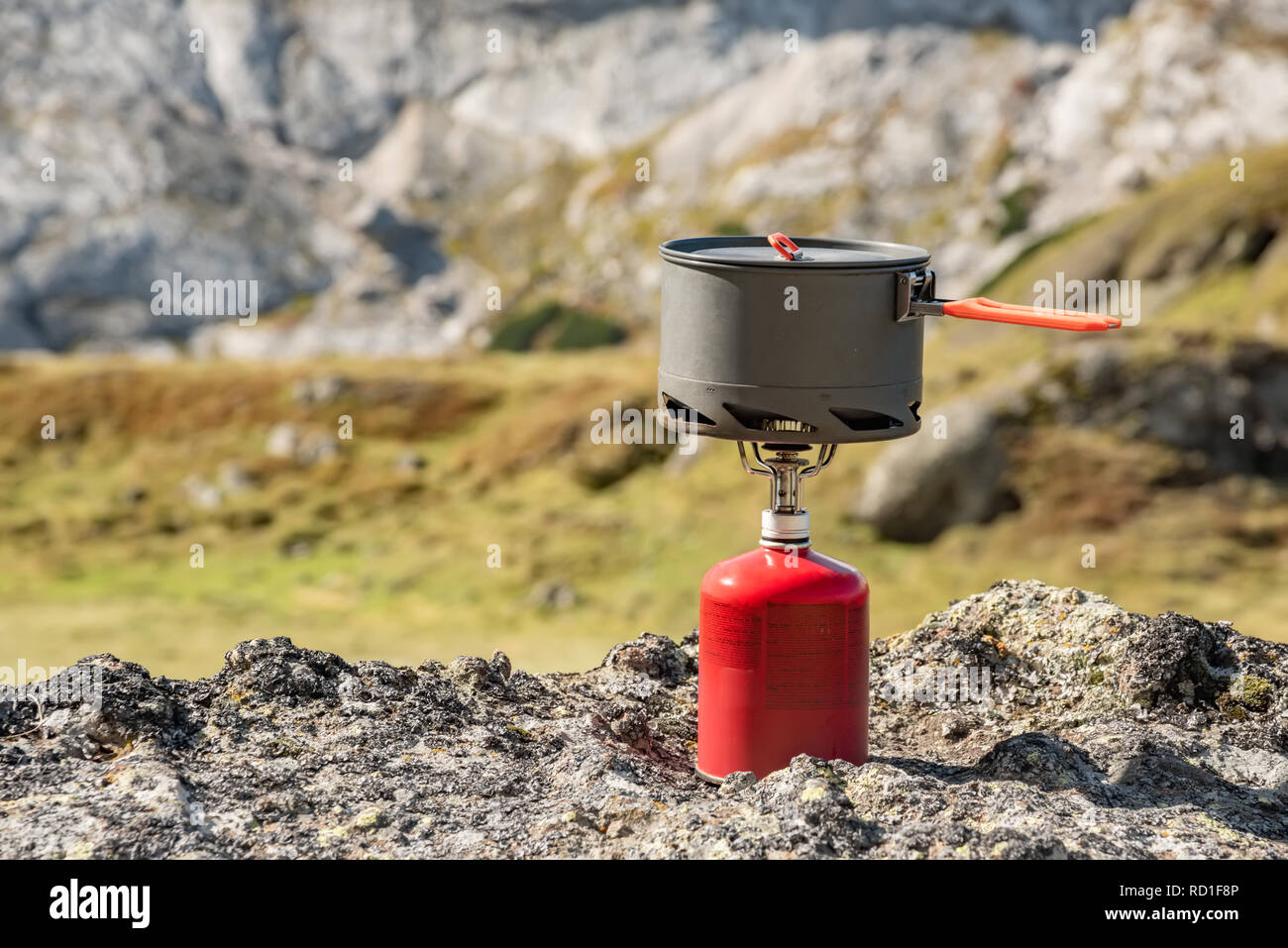 Tourist equipment and tools: camping gas over Marmolada mountain background Dolomites Italy Stock Photo