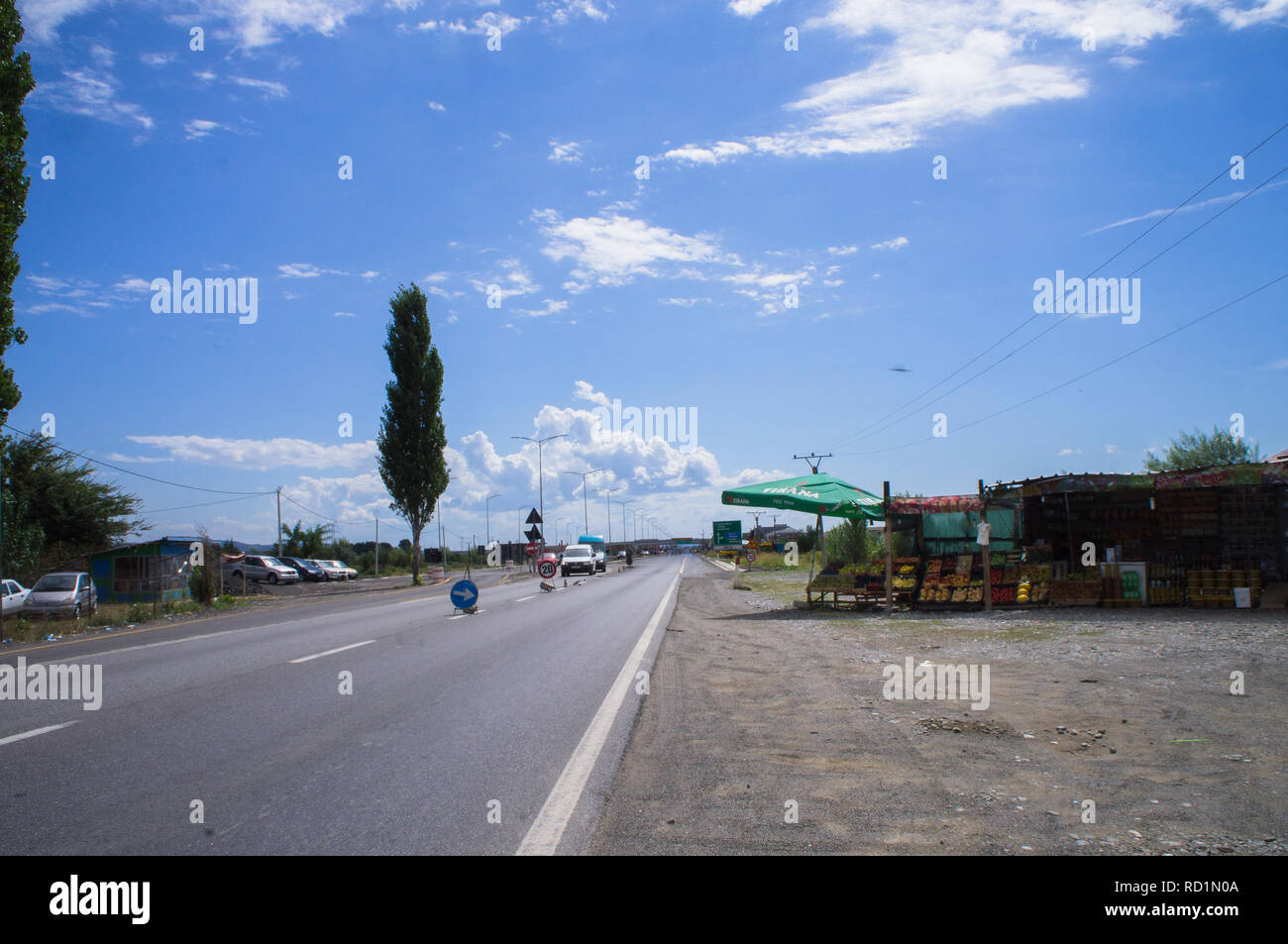 The fruit and vegetables shop by petrol station at outskirts of northern Albania`s city Shkoder (Shkodra or Skadar), one of the most ancient cities in - Stock Image