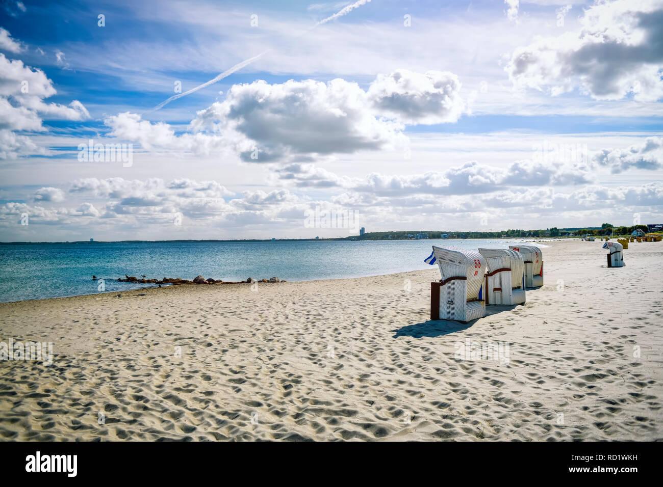 Beach and beach baskets on the Baltic Sea in lagoon jug, Schleswig - Holstein, Germany, Europe, Strand und Strandkörbe an der Ostsee in Haffkrug, Schl - Stock Image