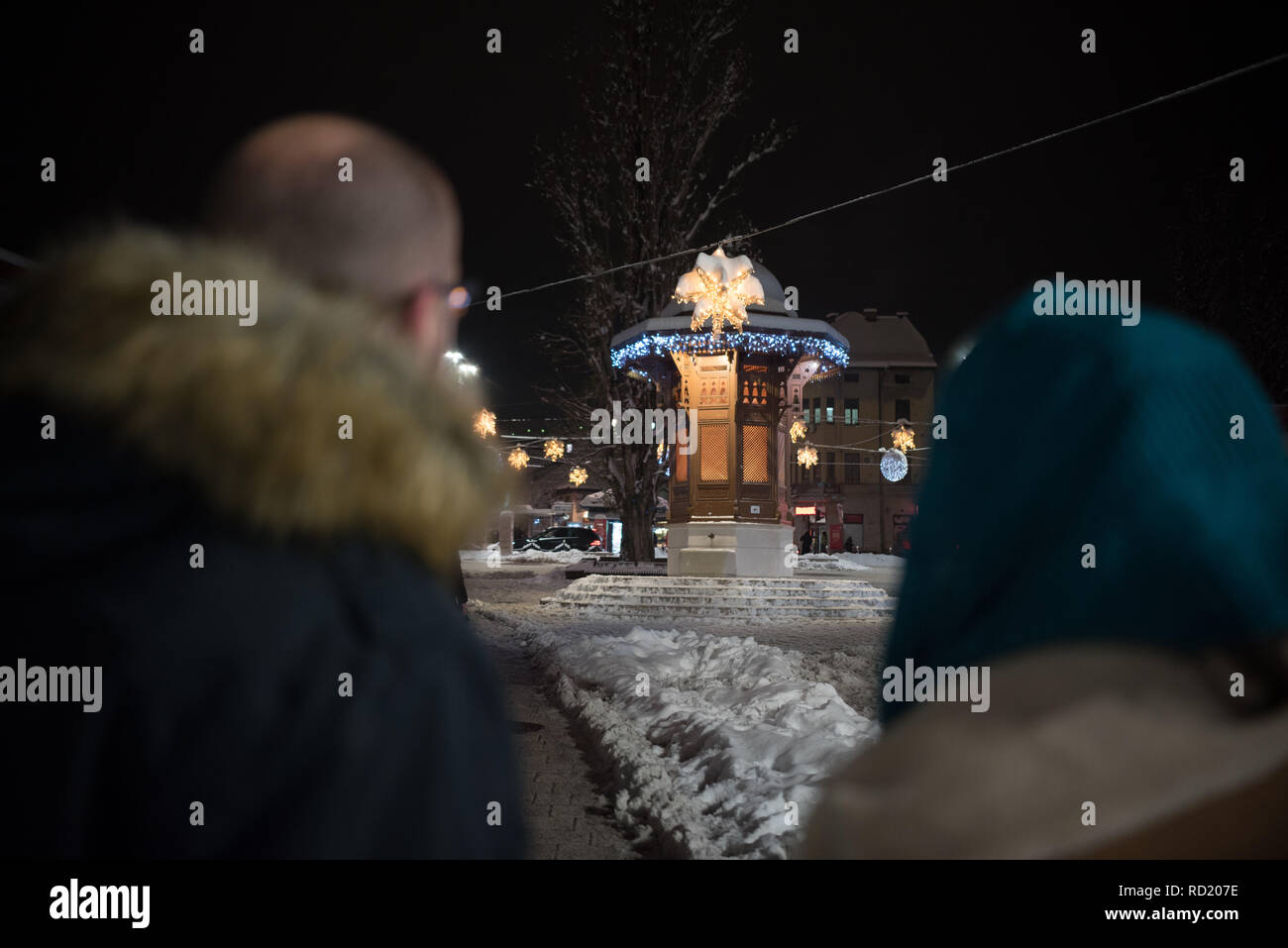 Christmas In Sarajevo.Rear View Of A Couple Looking At Christmas Lights Sarajevo