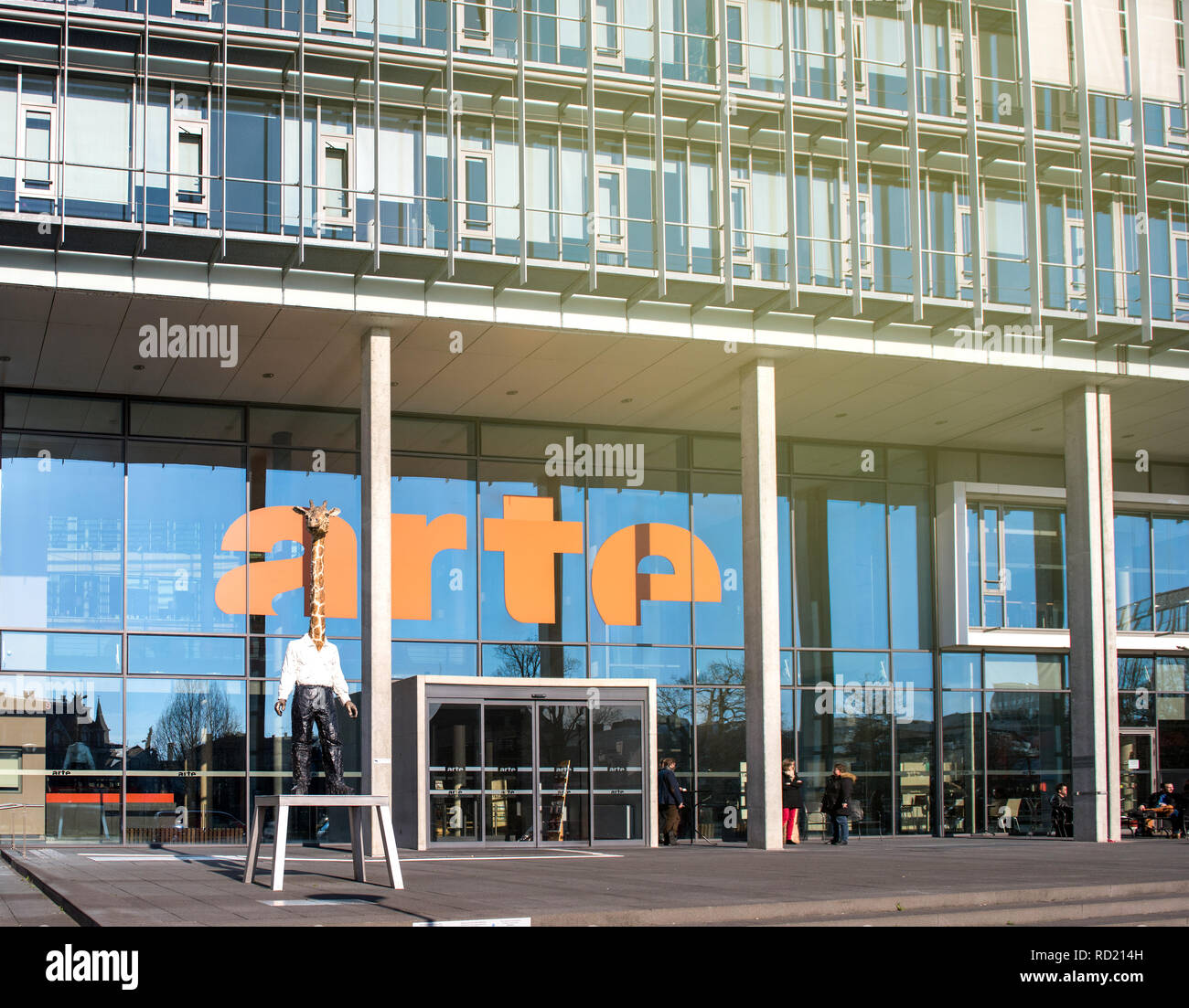 STRASBOURG, FRANCE - APR 6, 2018: Facade of Arte Association Relative a la Television Europeenne television headquarter in Strasbourg with the L'homme-girafe statue monument by Stephan Balkenhol. - Stock Image