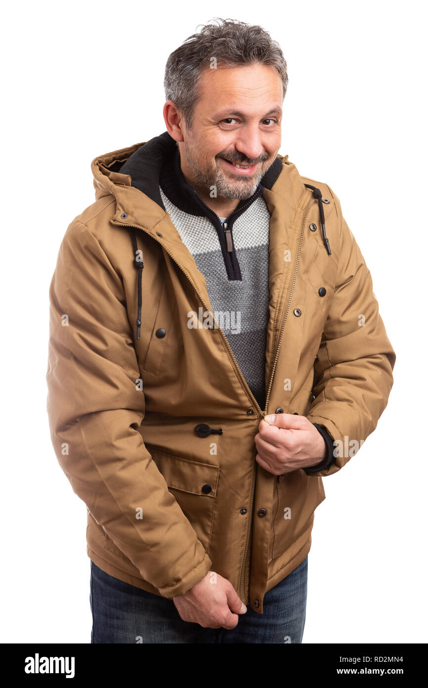Smiling male person zipping warm brown winter jacket as preparing to go out in cold weather isolated on white - Stock Image