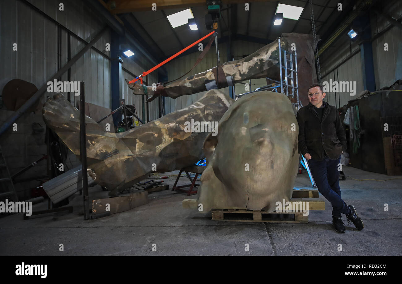 'Messenger' a 23 foot by 30 foot sculptor by artist Joseph Hillier, inside Castle Fine Arts Foundry, Llanrhaeadrym-Mochnant, Owestry. The Bronze piece has been commissioned by the Theatre Royal Plymouth and will be erected in March this year. - Stock Image