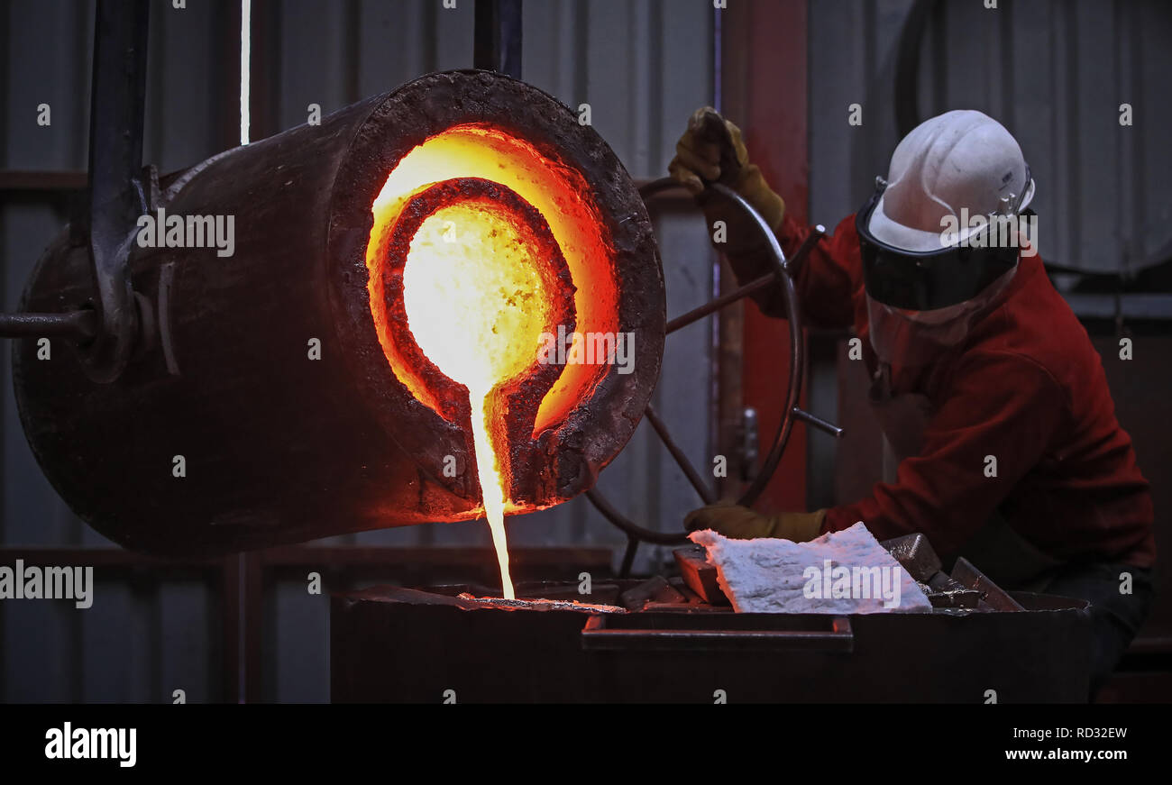 A foundry operator working on 'Messenger', a 23 foot by 30 foot sculpture by artist Joseph Hillier, inside Castle Fine Arts Foundry, Llanrhaeadrym-Mochnant, Owestry. The Bronze piece has been commissioned by the Theatre Royal Plymouth and will be erected in March this year. - Stock Image