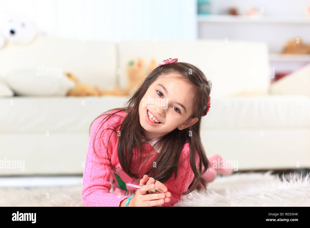 close up.little girl draws lying on the floor in the room Stock Photo