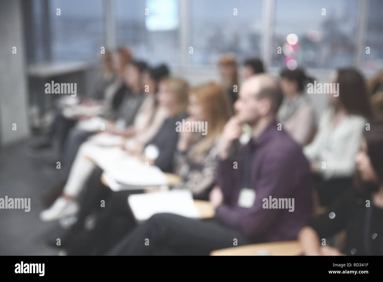 close up.blurred image of students in the conference hall - Stock Image