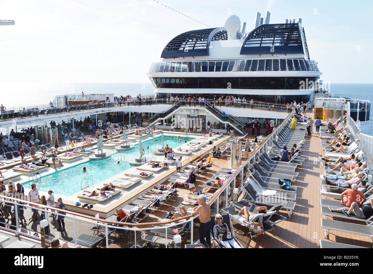 Panorama of the open deck with a luxurious pool and numerous tourists ship MSC Meraviglia, October 10, 2018. - Stock Image