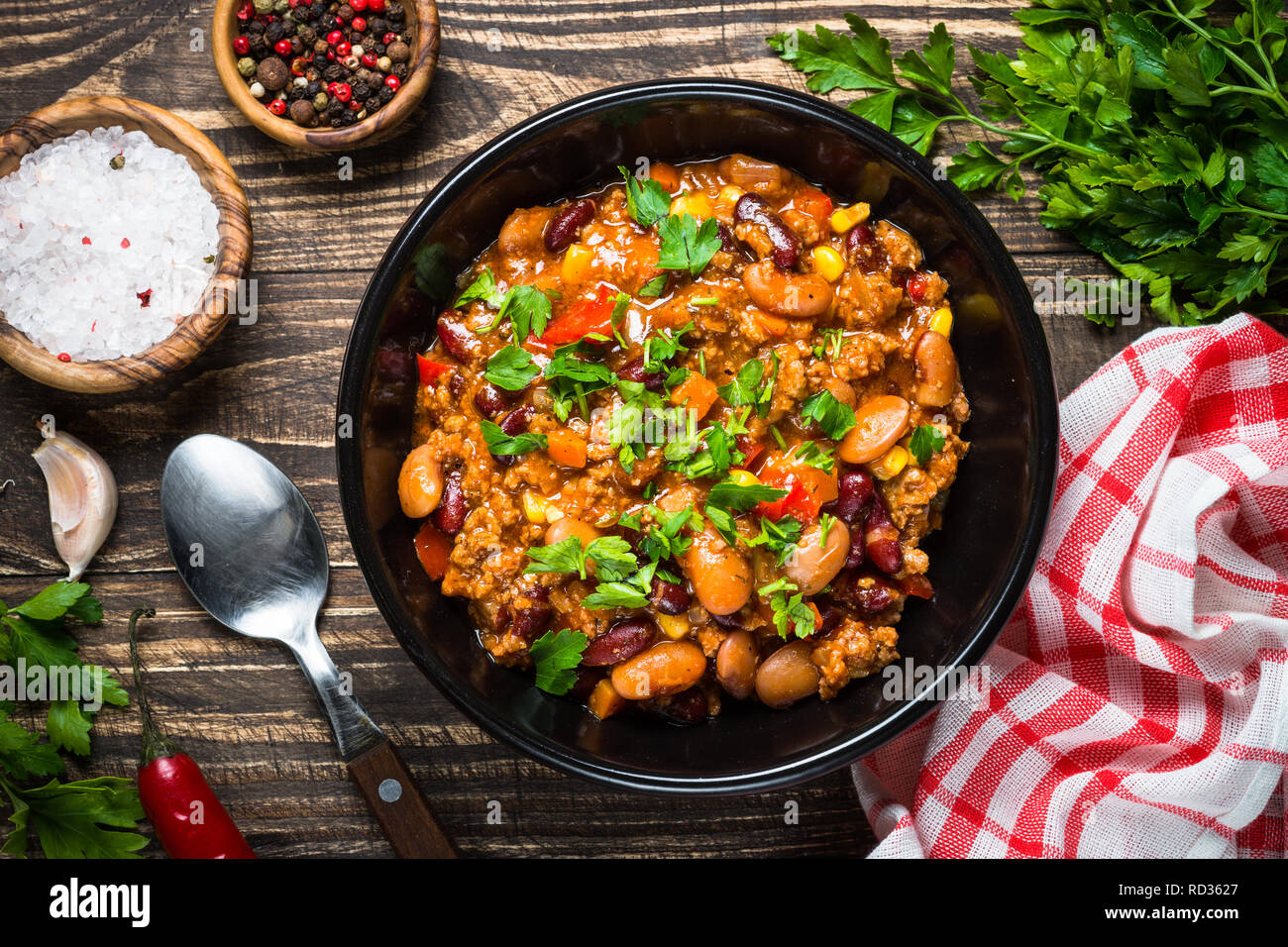 Chili Con Carne From Meat Beans And Vegetables On Dark Wooden Table Traditional Mexican Food Top View Stock Photo Alamy