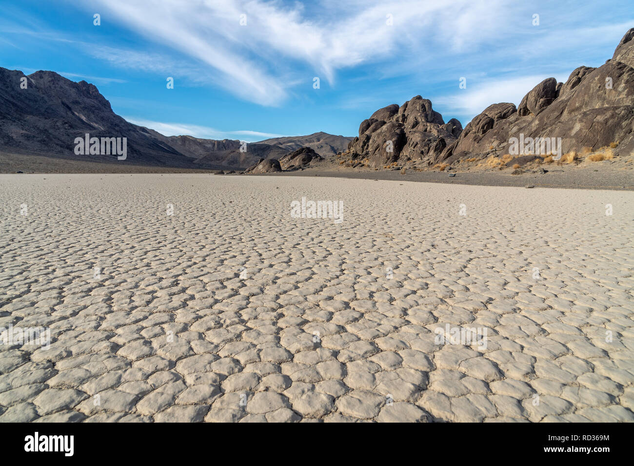 Dry lake bed formed polygon patterns, usually 6 sided, Racetrack Playa and The Grandstand Island, Death Valley National Park, California - Stock Image