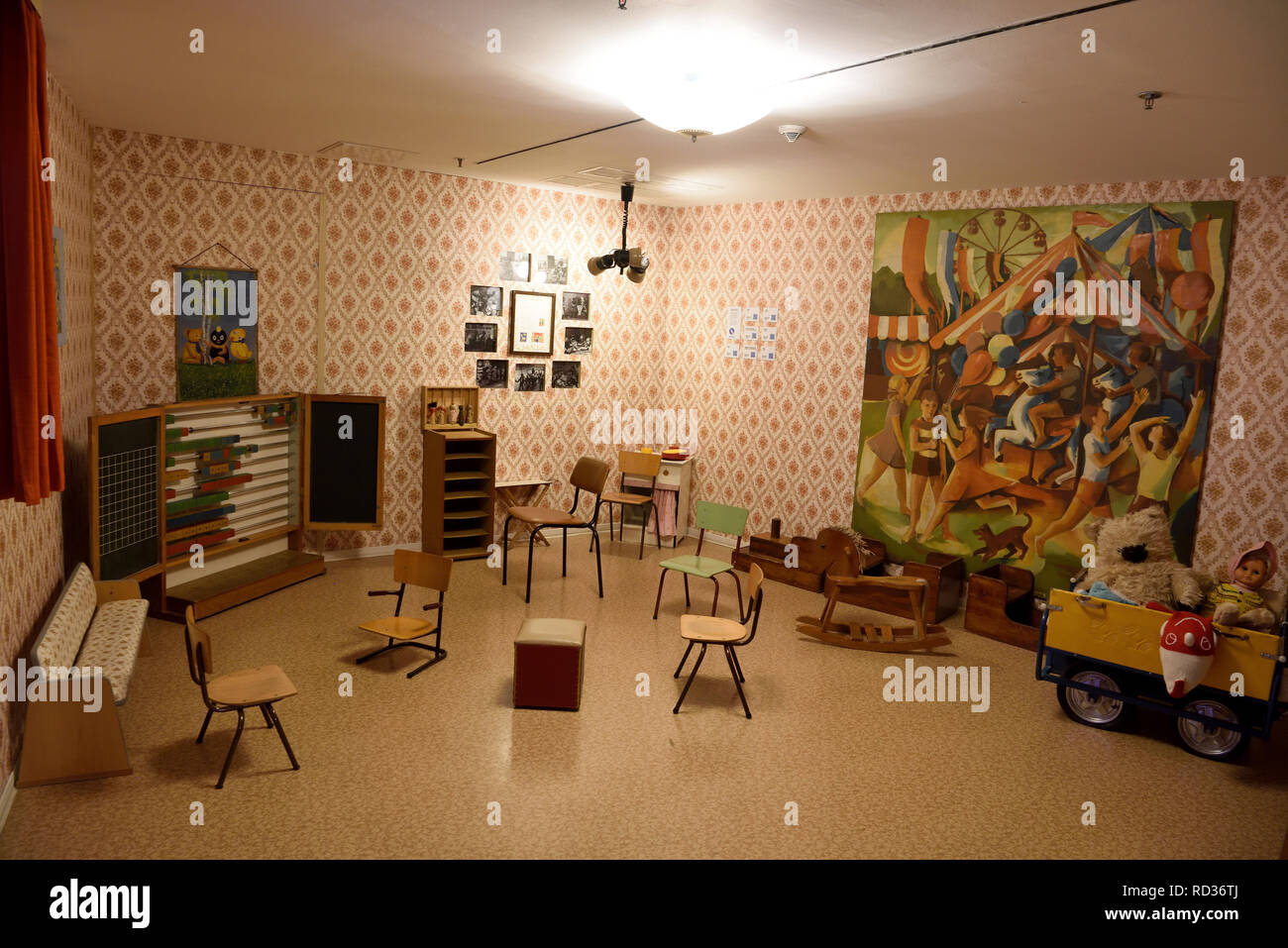 Berlin, Germany - November 10, 2018. Kindergarten room at DDR Museum in Berlin, with furniture and toys. - Stock Image