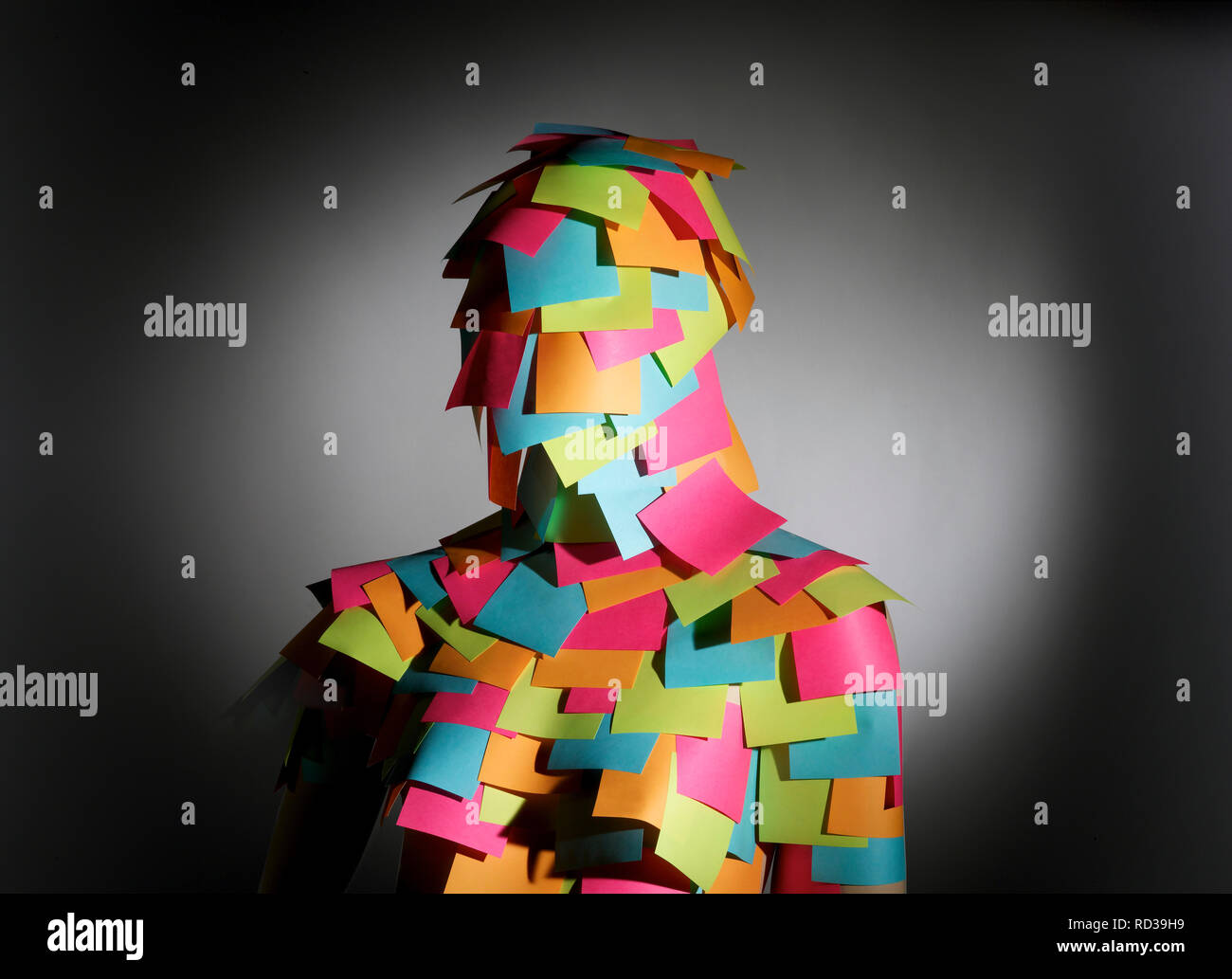 Businesswoman covered in colorful post it notes - Stock Image