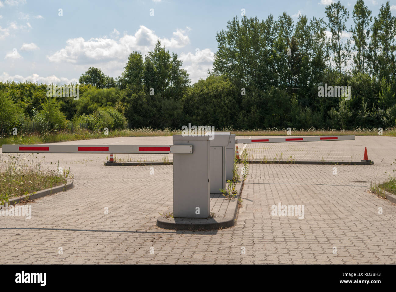 Parking entrance and exit blocked by barriers - Stock Image