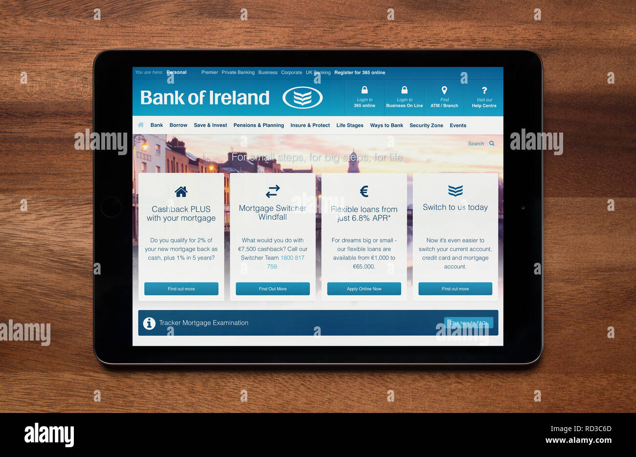 The website of Bank of Ireland is seen on an iPad tablet, which is resting on a wooden table (Editorial use only). - Stock Image