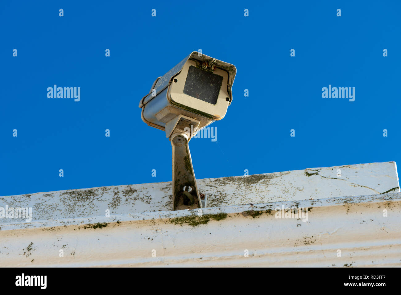 A CCTV security camera on a building. - Stock Image