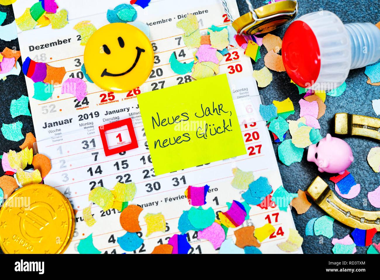 Calendar for 2019 and slip of paper with the label new year, new luck!, Kalender für das Jahr 2019 und Zettel mit der Aufschrift Neues Jahr, neues Glü Stock Photo