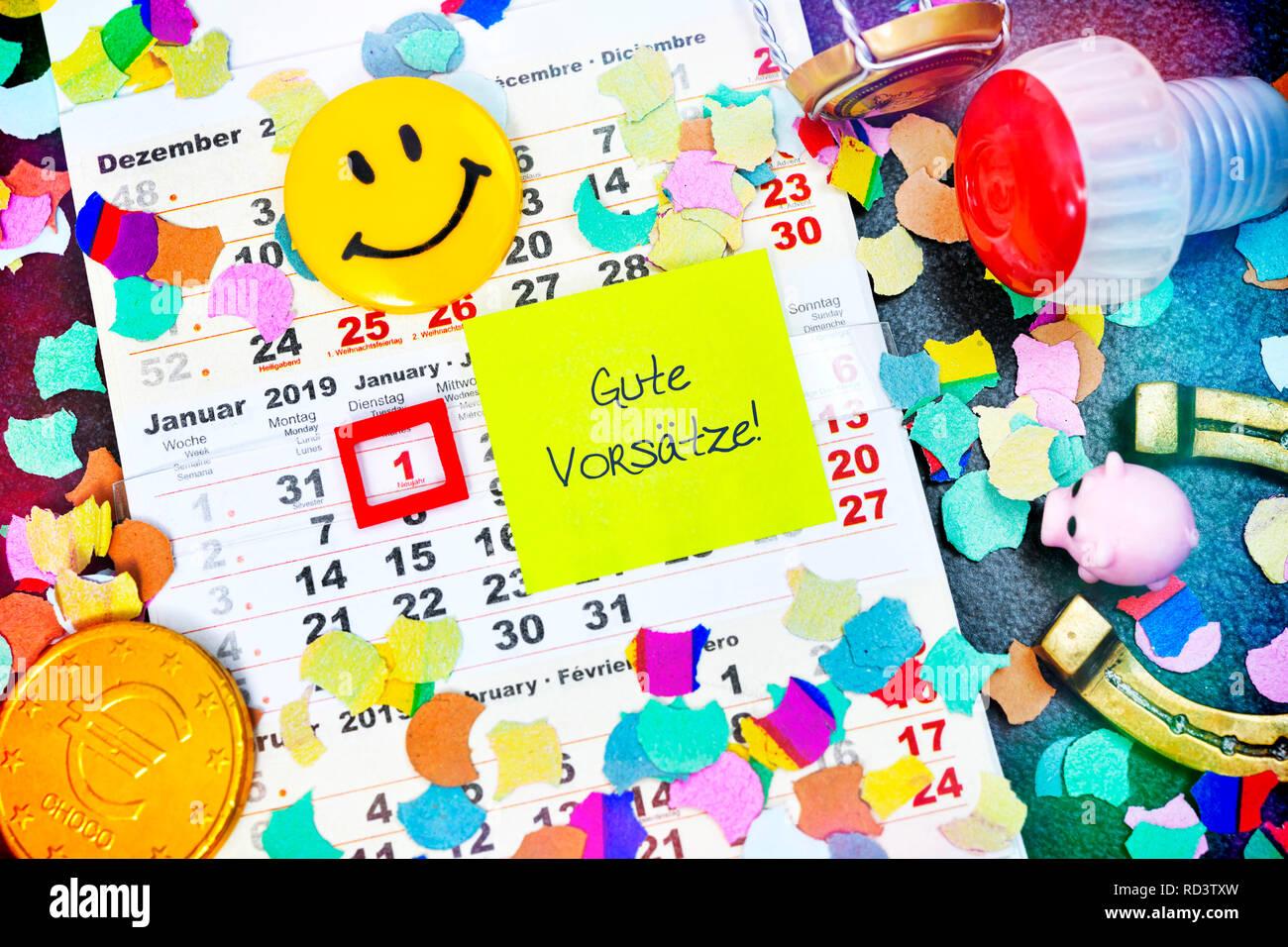Calendar for 2019 and slip of paper with the label good intentions!, Kalender für das Jahr 2019 und Zettel mit der Aufschrift Gute Vorsätze! Stock Photo