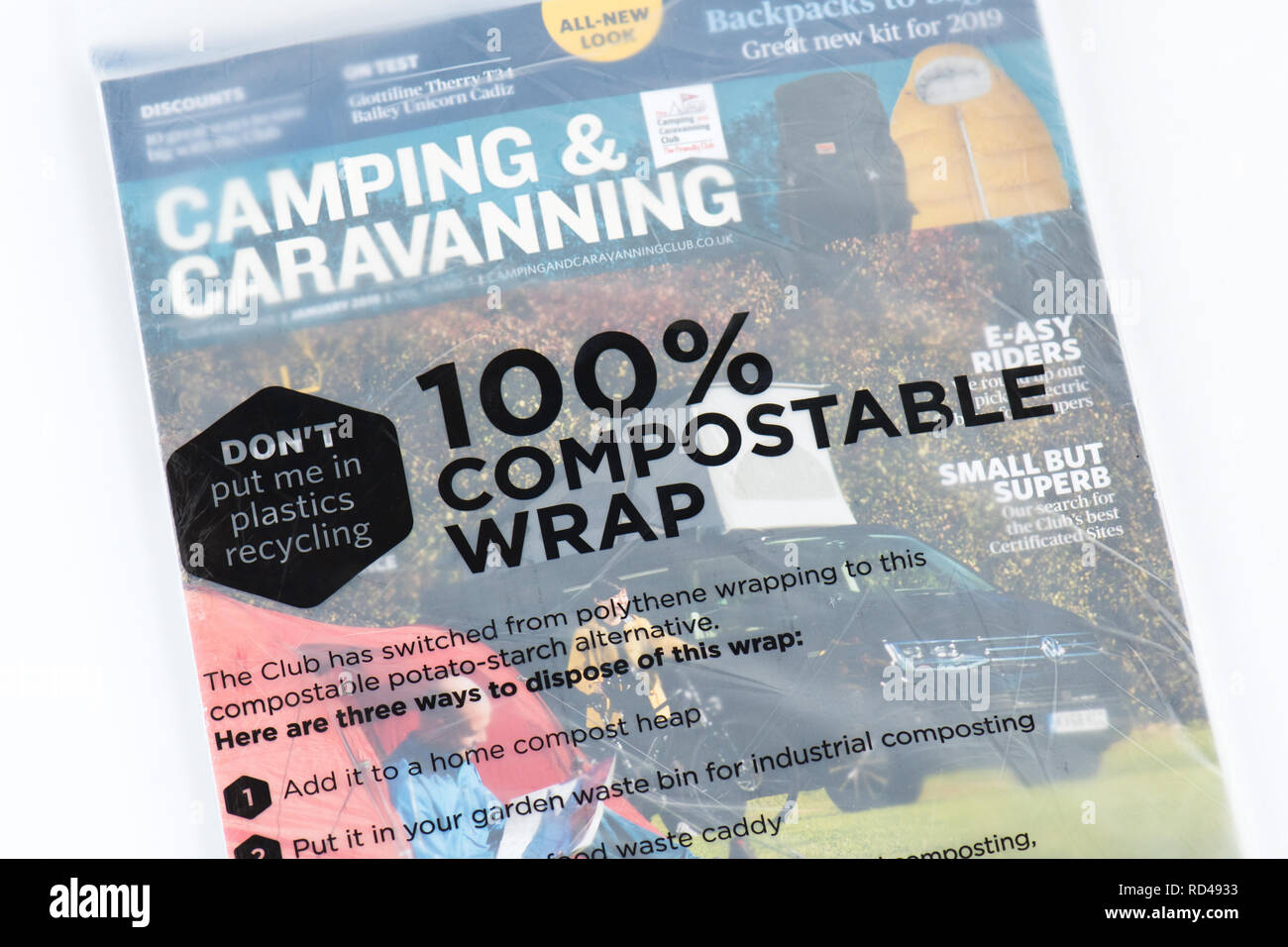 compostable wrap made from potato-starch wrapped around magazine - Stock Image