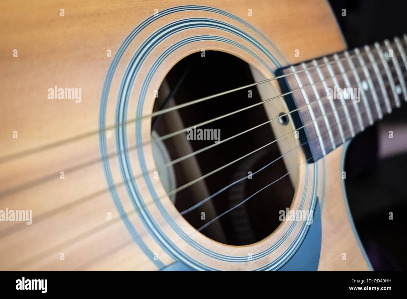 Trembling guitar string, electronic shutter distortion effect. Close-up image of resonating strings captured with wave effect - Stock Image