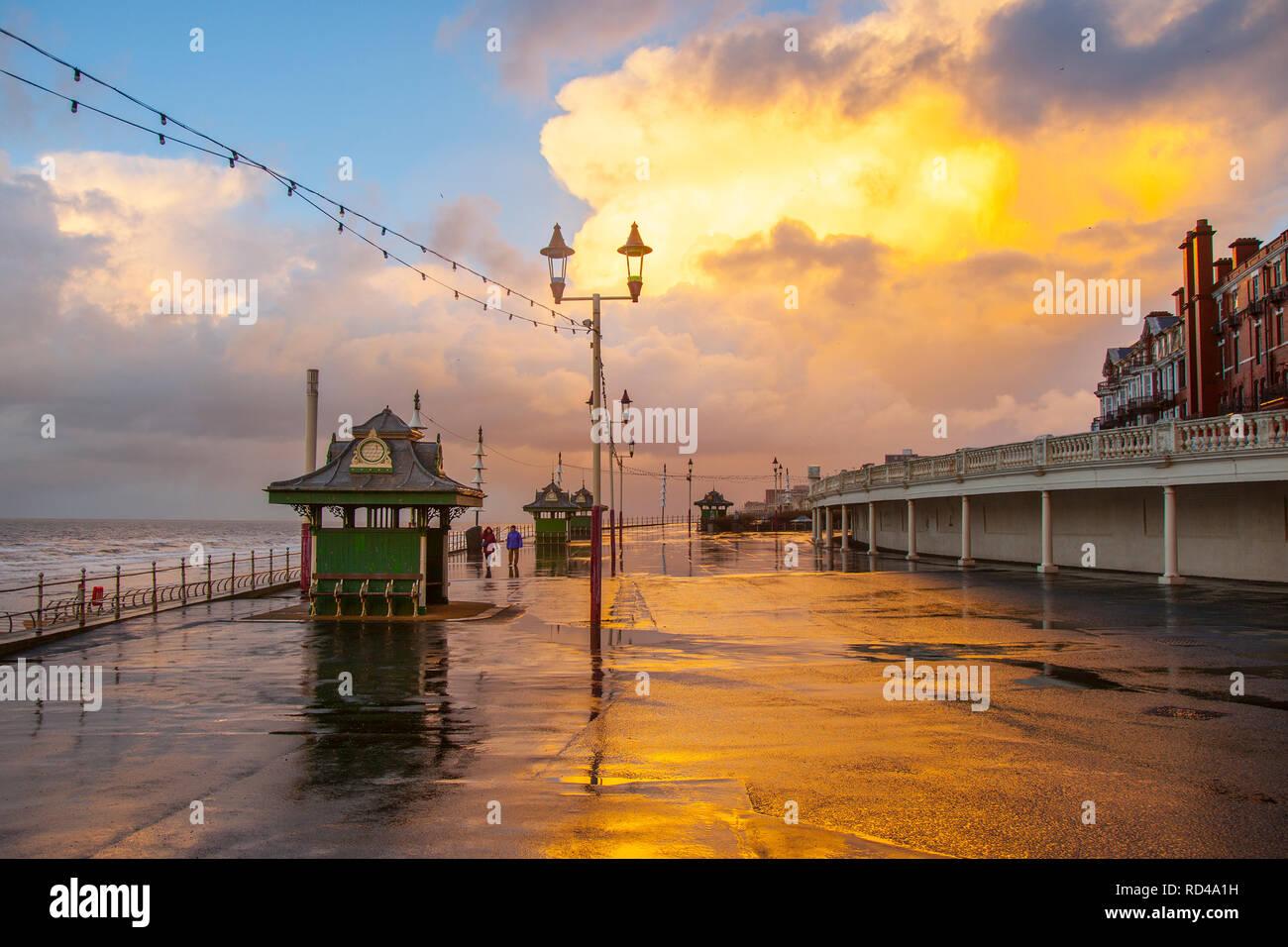 Blackpool,  Lancashire.  16th Dec 2019. UK Weather.  Wet & Windy & cold at sunset on the coast. Credit: MediaWorldImages/AlamyLiveNews. - Stock Image