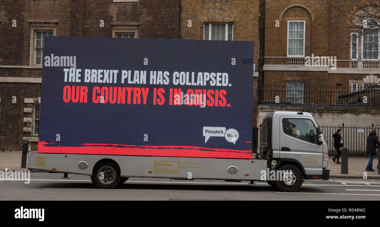 London, UK. January 16th, 2019. Large mobile and continuous changing billboards are driven near the Houses of Parliament, today, advertising and encouraging the creation of a People's Vote on Brexit. Credit: Joe Kuis / Alamy Live News - Stock Image