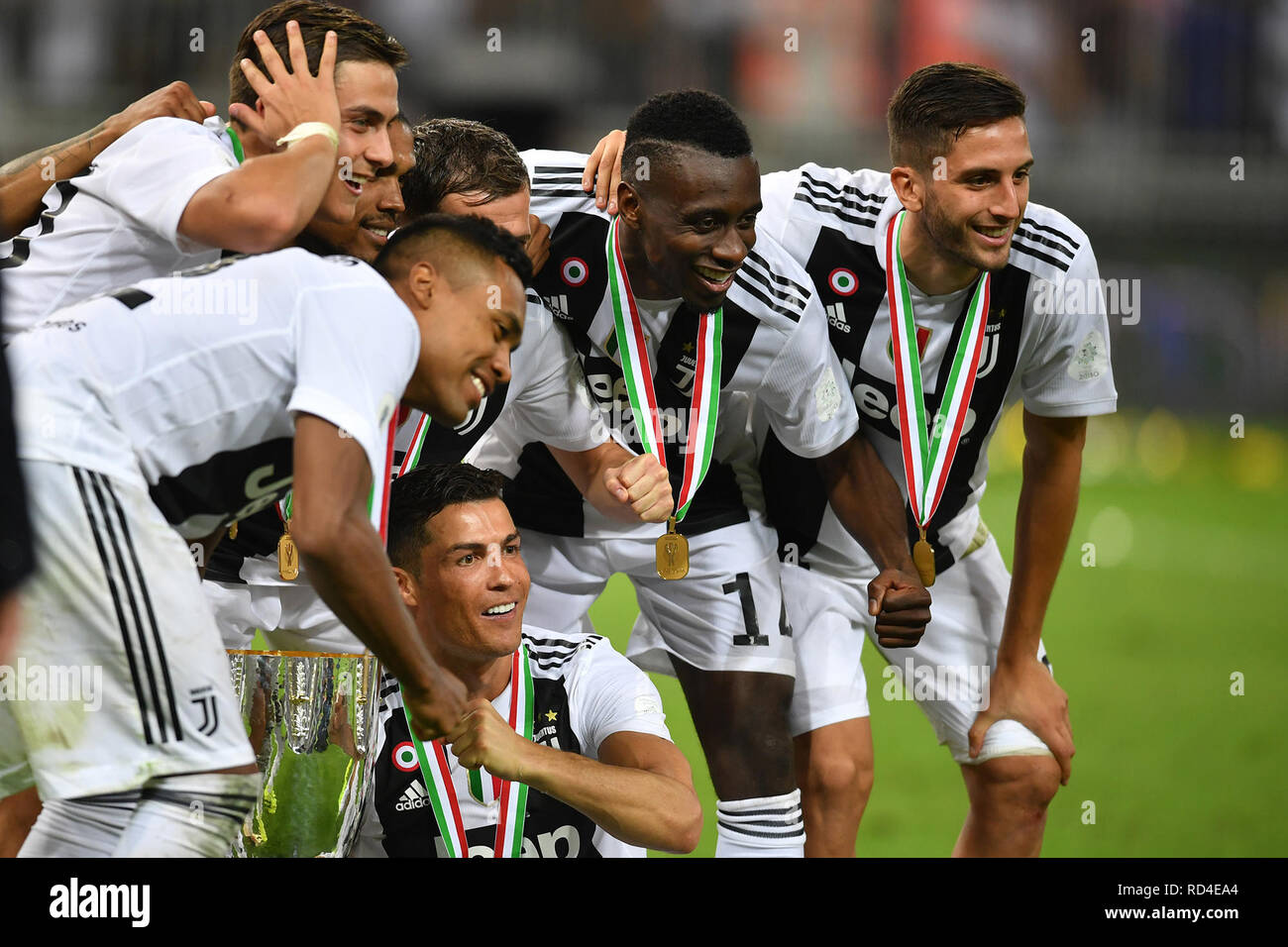 Jeddah, Saudi Arabia. 16th Jan, 2019. Juventus players celebrate with a trophy after wining the Italian Super Cup final soccer match between Juventus and AC Milan at the King Abdullah Sports City Stadium. Credit: -/dpa/Alamy Live News - Stock Image