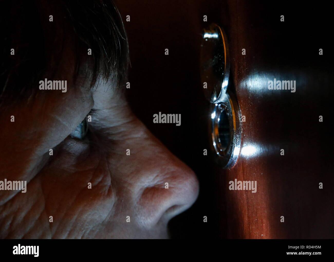 ROSTOV-ON-DON, RUSSIA - JANUARY 10, 2019: A woman looks through a peephole. Valery Matytsin/TASS - Stock Image