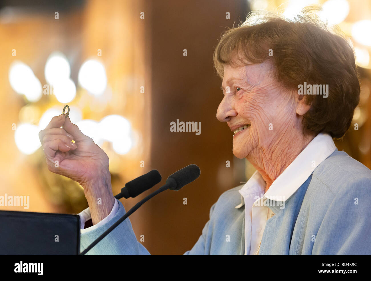 Hamburg, Germany. 17th Jan, 2019. The survivor of the concentration camps Auschwitz and Neuengamme, Edith Kraus, shows 'A City and its Concentration Camp. prisoners of the Neuengamme concentration camp in everyday Hamburg wartime 1943-1945' a ring that they had secretly received from a German during their forced labor time in Hamburg. At least 42,900 people died in Neuengamme concentration camp and its satellite camps. Credit: Ulrich Perrey/dpa/Alamy Live News - Stock Image