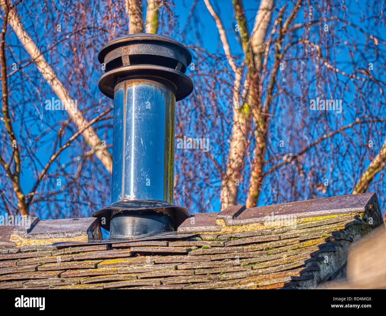 Wirksworth, UK. 17th Jan, 2019. UK Weather: An old log-burning stove warming a farm house on a cold January day, maybe under-threat from Michael Gove's Clean Air Strategy, Wirksworth, Derbyshire Dales Credit: Doug Blane/Alamy Live News - Stock Image