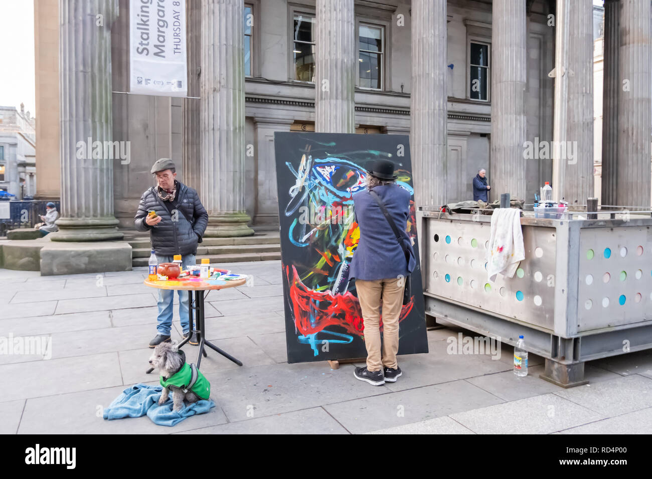 Glasgow, Scotland, UK. 17th January, 2019. The artist Frankie Patrick Robertson painting outside The Gallery Of Modern Art (GOMA). Credit: Skully/Alamy Live News - Stock Image