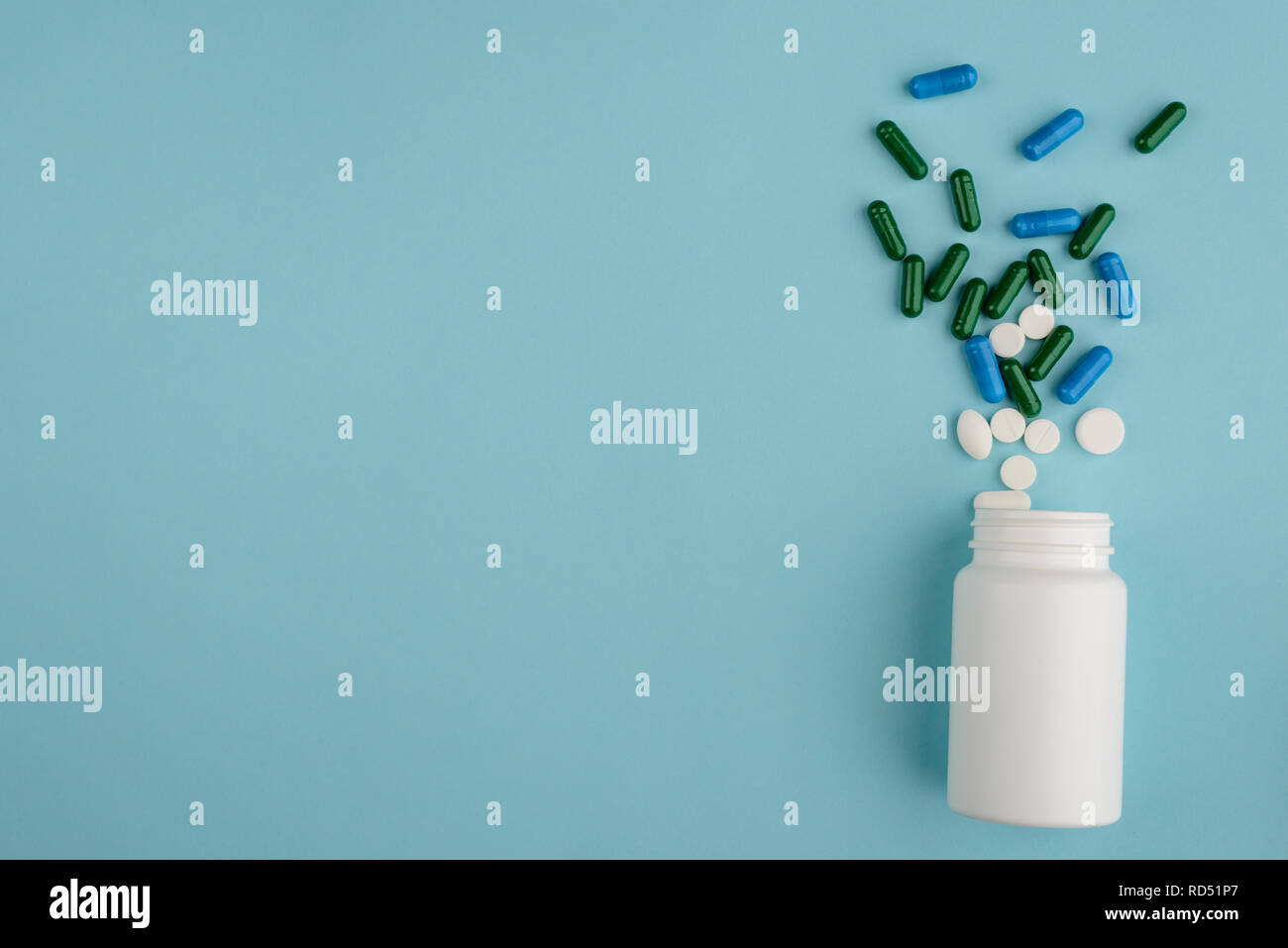 Plastic bottle and spilled pills Stock Photo