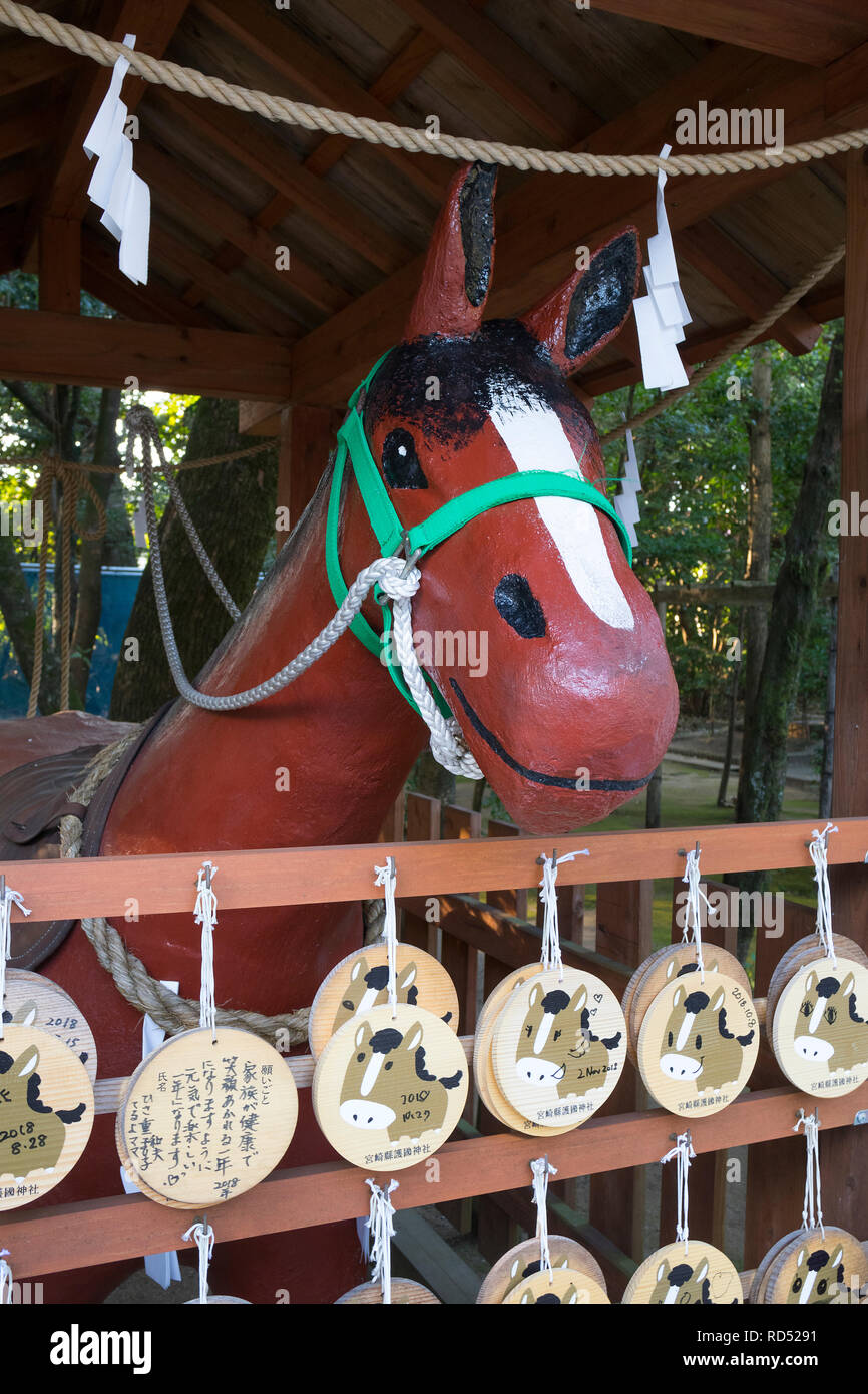 Miyazaki, Japan - November 5, 2018: Nade Uma, Rubbing horse, shrine to console the spirits of war horses at the Miyazaki Jingu shrine grounds - Stock Image