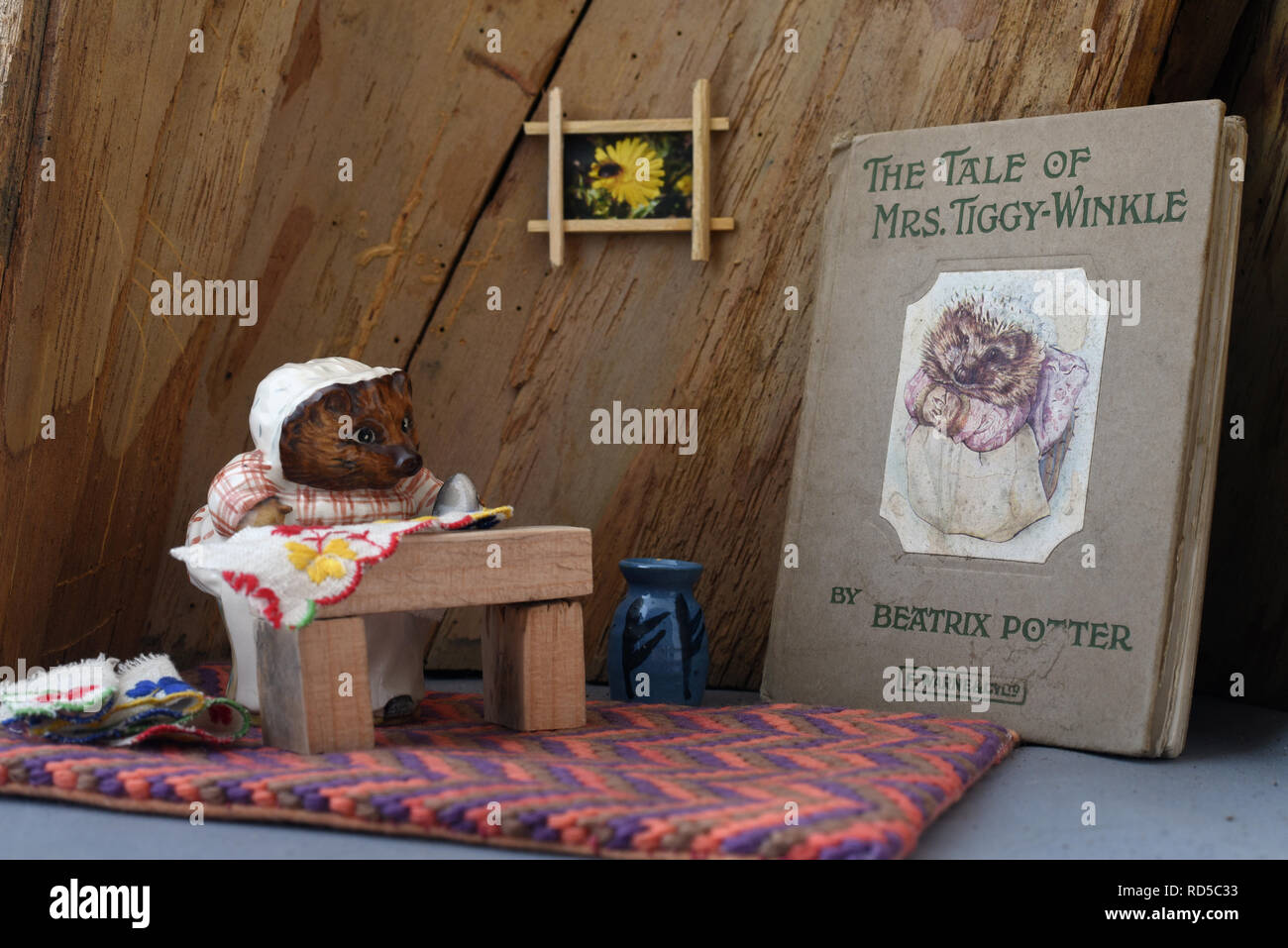 Vintage Beatrix Potter book of the Tale of Mrs Tiggy-Winkle and Beswick Pottery figure. Still Life - Stock Image