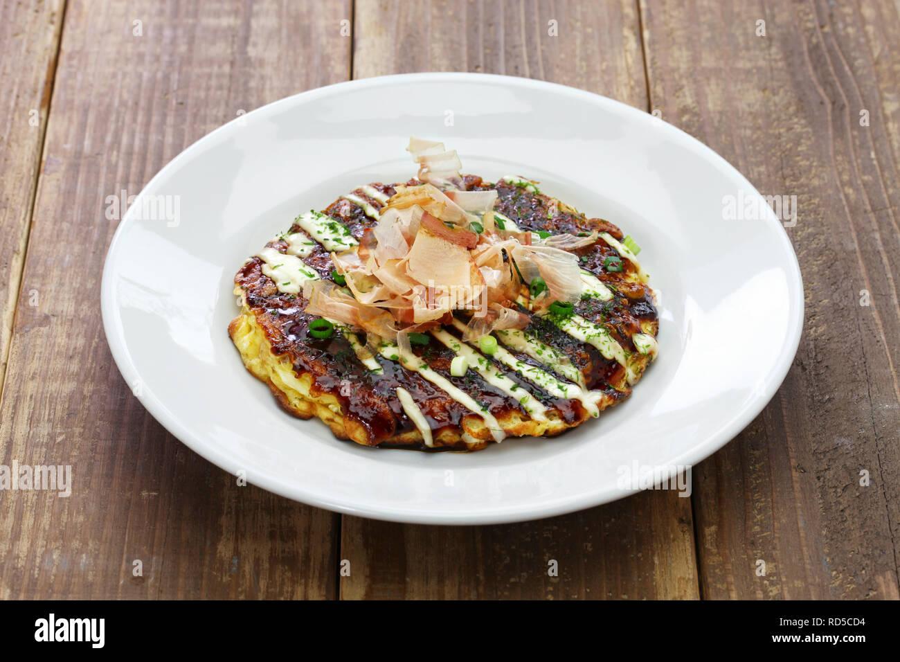 Okonomiyaki is a Japanese savory pancake containing a variety of ingredients. - Stock Image