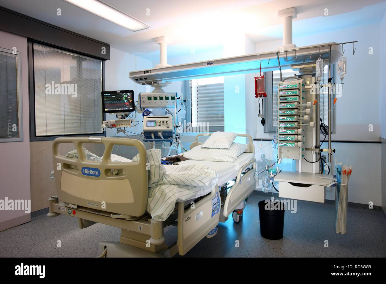 ICU or intensive care unit, empty patient bed ready for a new patient, medical equipment for the care, ventilation and - Stock Image