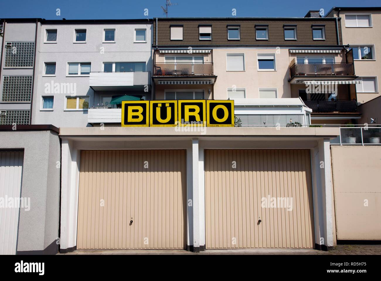 Garages for cars, above a sign saying 'Buero', German for office, Gelsenkirchen, North Rhine-Westphalia - Stock Image