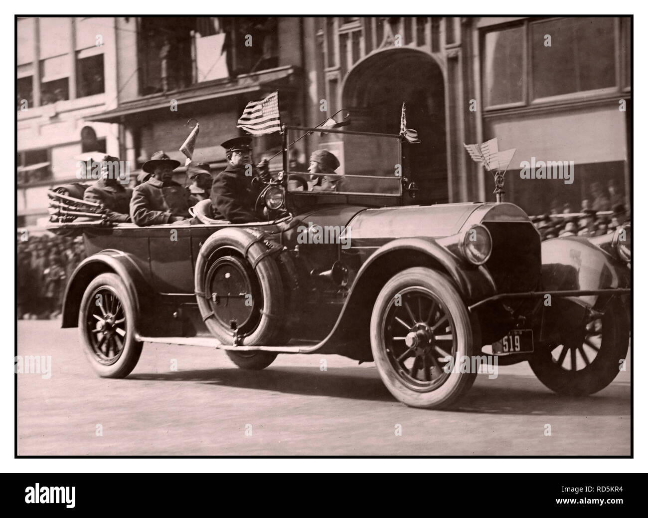 Feb. 17, 1919 Wounded soldiers of the 369th ride in their victory parade. Harlem Hell Fighters of the 369th 1918-1919 The 369th Infantry Regiment was the first African-American regiment to fight in World War I. First constituted on June 2, 1913 as the 15th New York Infantry Regiment of the New York Army National Guard, it was renamed to the 369th in 1918. Harlem Hellfighters The black heroes of the 369th… - Stock Image