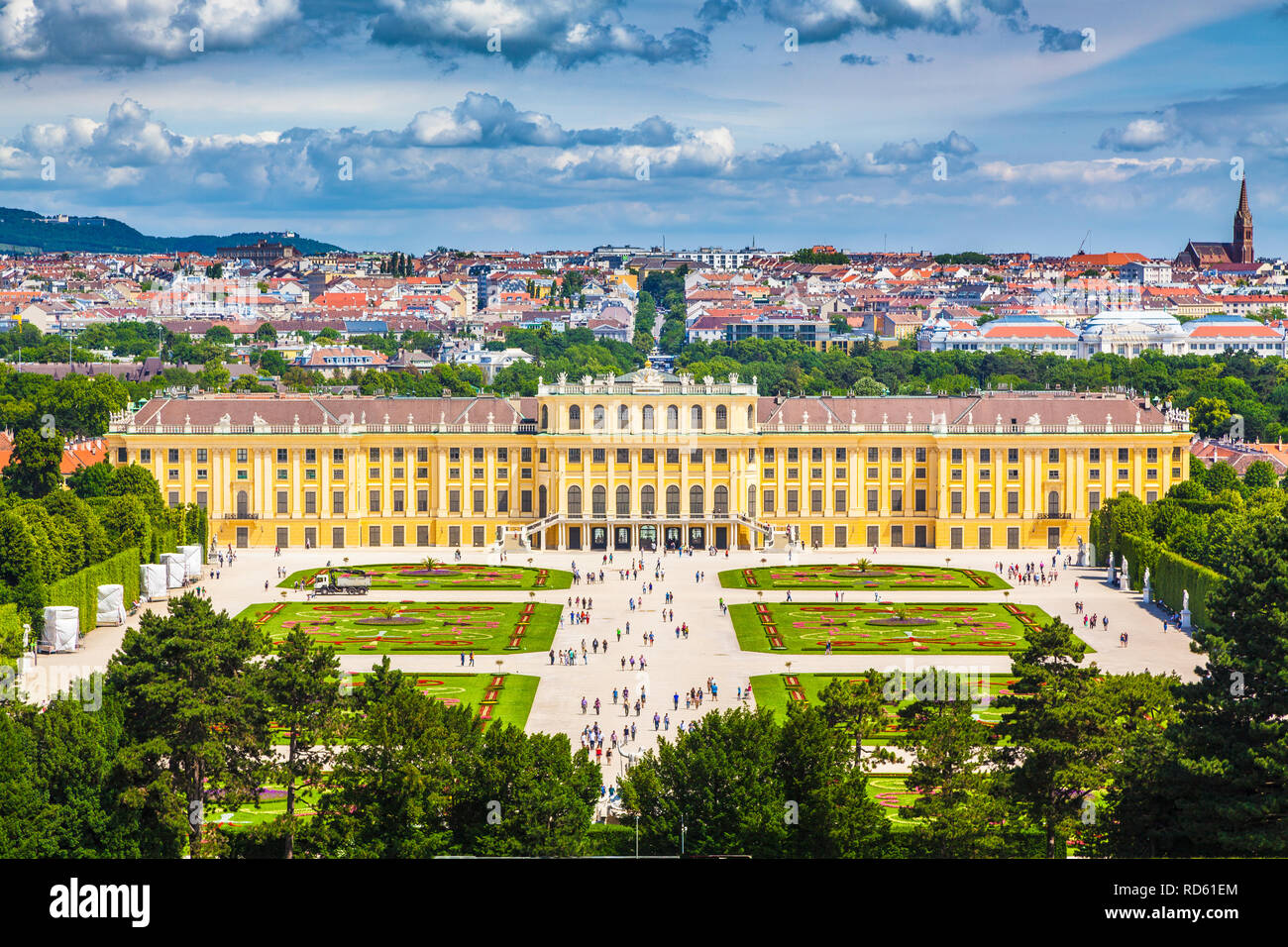 Classic view of famous Schonbrunn Palace with Great Parterre garden on a beautiful sunny day with blue sky and clouds in summer, Vienna, Austria - Stock Image