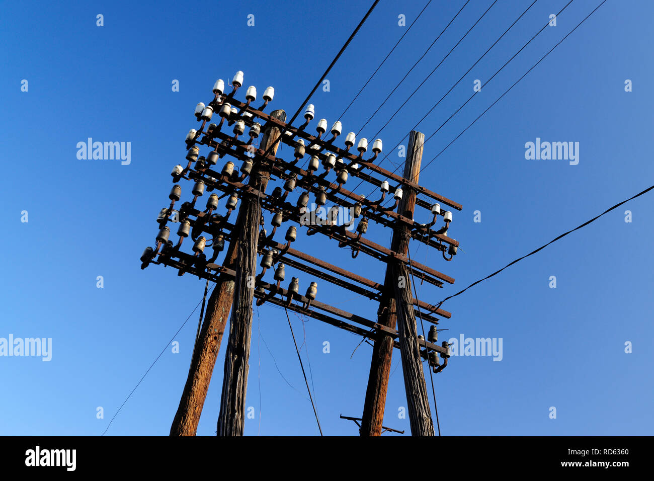 sloop, energy, transmission, conventional, old, porcelain, connection, voltage, electricity, high, low, wood, wooden, danger, cables, transformer stat - Stock Image