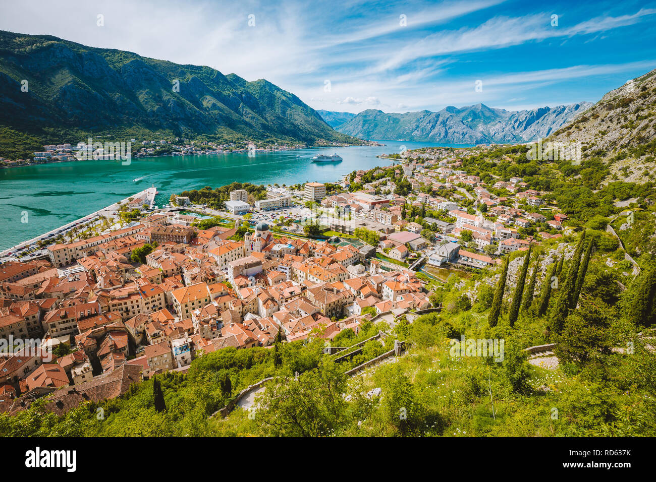 Scenic panoramic view of the historic town of Kotor with famous Bay of Kotor on a beautiful sunny day with blue sky and clouds, Montenegro, Balkans - Stock Image